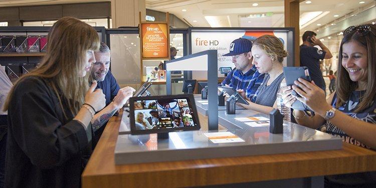 Screenshot showing people at an amazon retail store